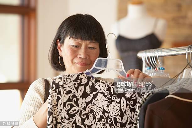Senior Asian woman shopping for clothing