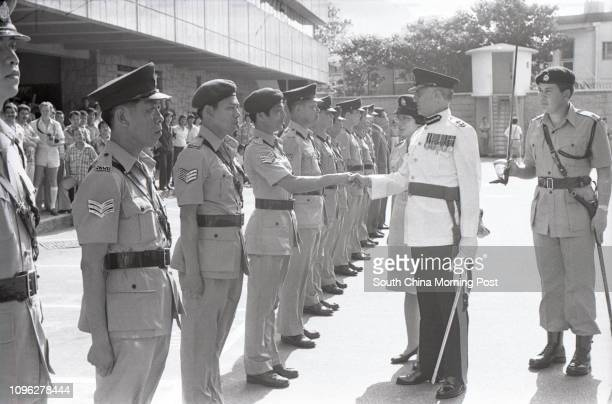 Senior Assistant Commissioner of Police Charles Scobell who is the Director of Personnel and Support of the Royal Hong Kong Police Force inspecting a...