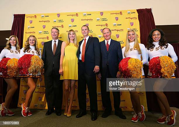 USC Senior Associate Athletic Director Steve Lopes Amanda Enfield Andy Enfield USC Athletic Director Pat Haden and USC cheerleaders pose for a photo...