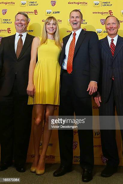 USC Senior Associate Athletic Director Steve Lopes Amanda Enfield Andy Enfield and USC Athletic Director Pat Haden pose for a photo after introducing...