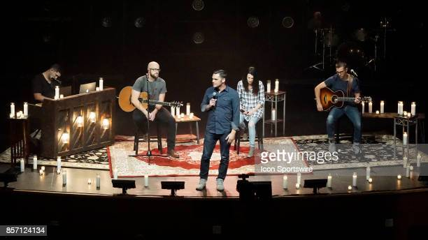 Senior Associate Pastor Drew Moore of Canyon Ridge Christian Church speaks to 3000 people during a prayer vigil at Canyon Ridge Christian Church in...