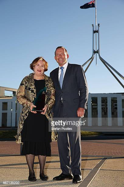 Senior Australian of the Year Jackie French poses with Prime Minister Tony Abbott during the 2015 Australian of the Year Awards at Parliament House...
