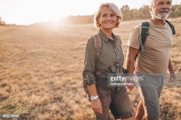 senior backpackers - outdoor pursuit stock pictures, royalty-free photos & images