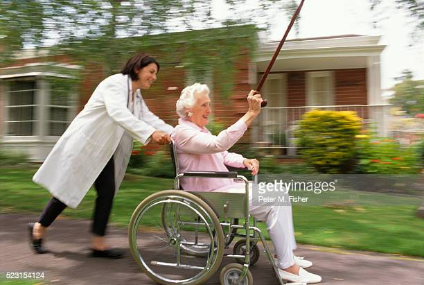 Senior Being Pushed in Wheelchair
