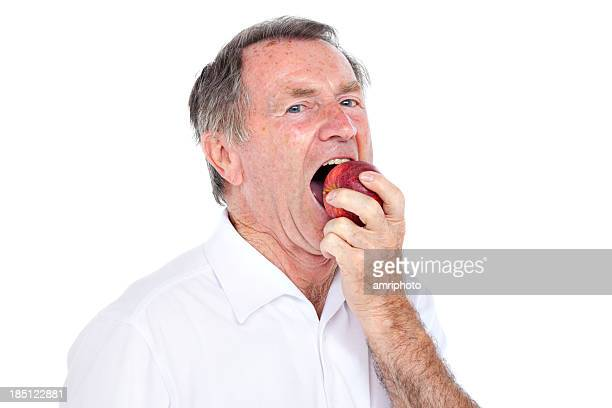 senior biting in apple