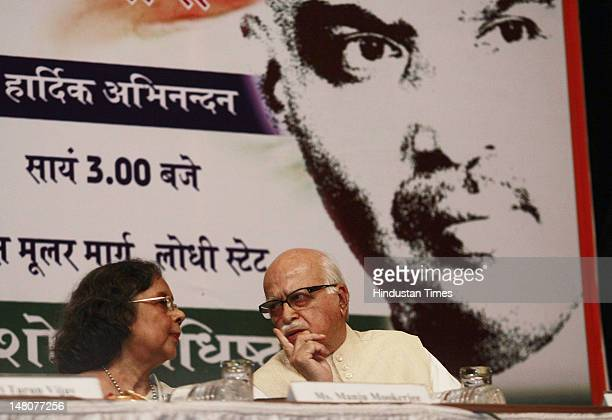 Senior BJP leader L K Advani and Manju Mookerjee Grand Daughter of Dr Shyama Prasad Mukherjee celebrate the birth anniversary of Dr Shyama Prasad at...