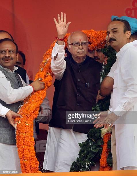 Senior BJP leader L K Advani waving to the party supporters at the end of his 'Jan Chetna Yatra' at Ramlila maidan in New Delhi India on November 20...