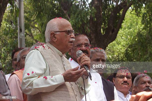 Senior BJP leader LK Advani address Bharatiya Janata Party supporters after the victory of the party in General Elections 2014 outside the BJP...