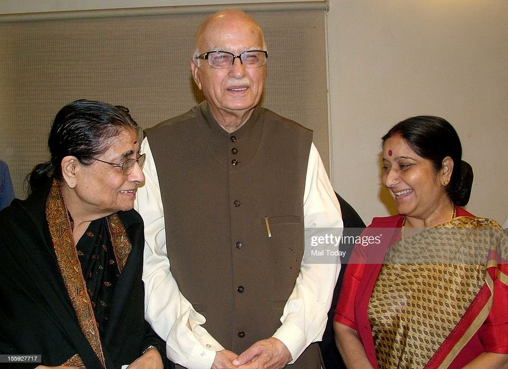 Senior BJP leader LK Advani along with his wife Kamla Advani and BJP leader Sushma Swaraj (R) receiving his birthday wishes in New Delhi on Thursday.