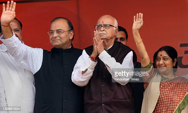 Senior BJP leader LK Advani along with Sushma Swaraj and Arun Jaitley wave during last public meeting of his Jan Chetna Yatra at Ramlila maidan in...