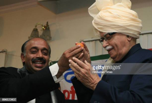 Senior BJP leader LK Advani being offered sweets by party senior leader Vijay Goel during his felicitation function organized by party leaders in New...