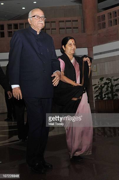 Senior BJP leaders LK Advani and Sushma Swaraj after an allparty meeting convened by Lok Sabha Speaker Meira Kumar in New Delhi on November 30 2010