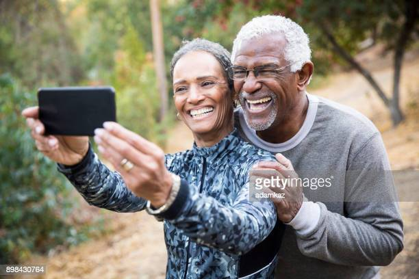 Senior Black Couple Taking Selfie During Exercise