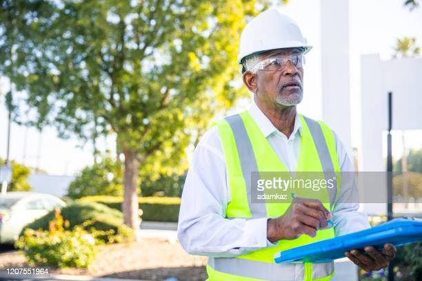 senior black man construction manager inspection - inspector stock pictures, royalty-free photos & images