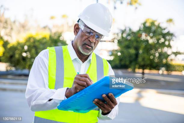 senior black man construction manager inspection - examining stock pictures, royalty-free photos & images