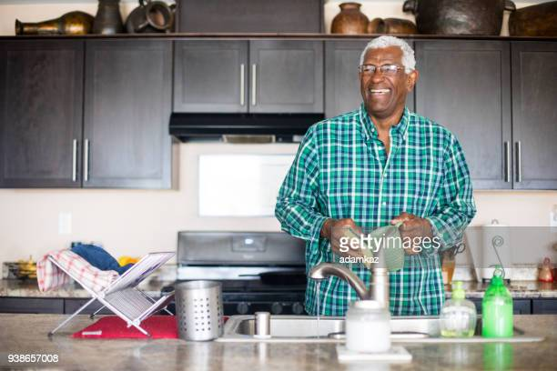 Senior Black Man Cooking Breakfast in Kitchen