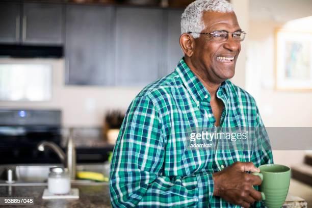 Senior Black Man Drinking Morning Coffee at Home