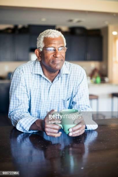 Senior Black Man Enjoying a Cup of Coffee at Home