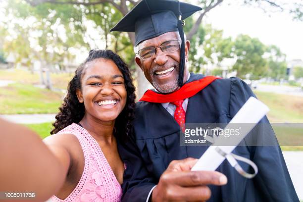 senior black man graduate with his daughter - old university stock pictures, royalty-free photos & images