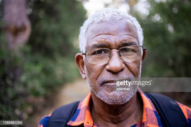 senior black man hiking in nature - adamkaz stock pictures, royalty-free photos & images