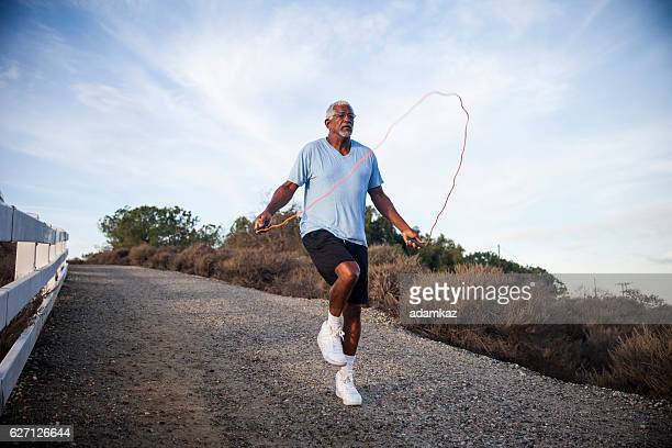 Senior Black Man Jumping Rope Outdoors