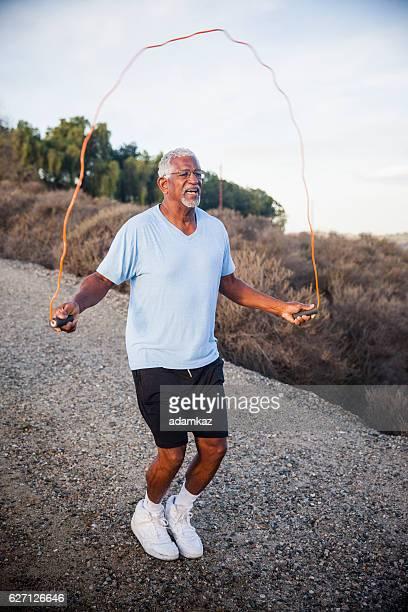 Senior Black Man Jumping Rope Outdoors