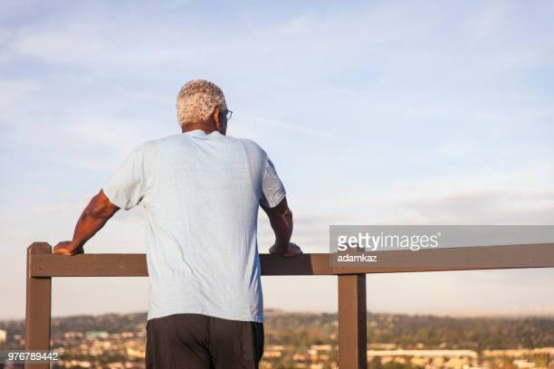 senior black man looking at the view - only senior men stock pictures, royalty-free photos & images
