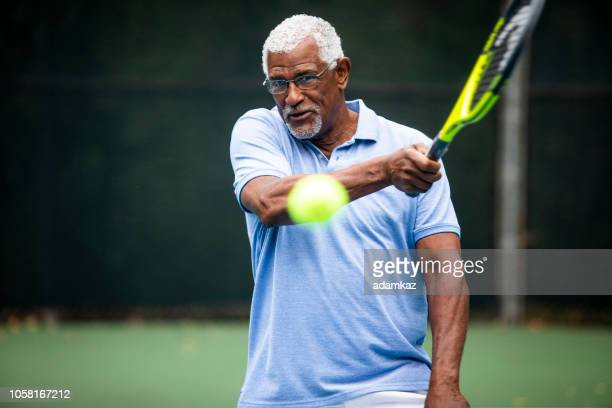 Senior Black Man Playing Tennis