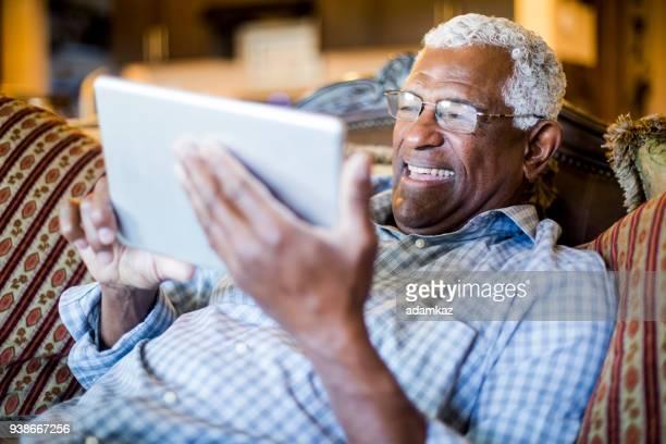 Senior Black Man Streaming on Tablet