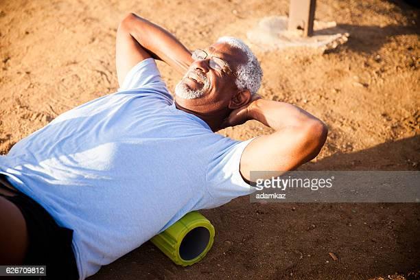 Senior Black Man Using Foam Roller