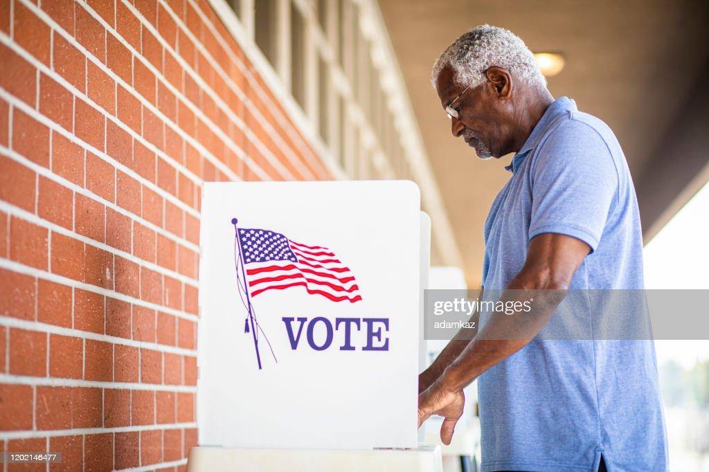 Senior Black Man Voting at Booth : Stock Photo