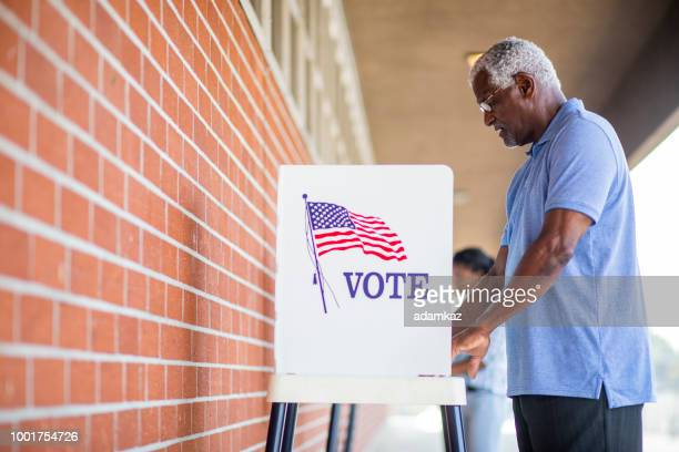 senior black man voting - kiosk stock pictures, royalty-free photos & images