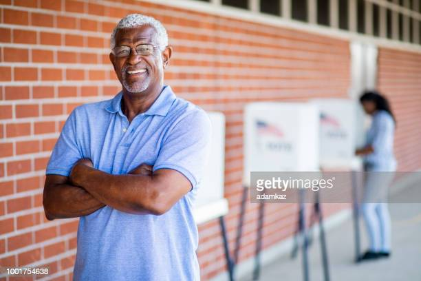 senior black man voting portrait - democratic party usa stock pictures, royalty-free photos & images