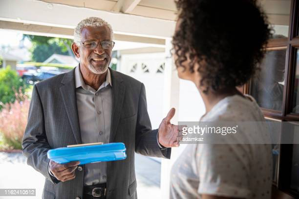 senior black politician door to door - election stock pictures, royalty-free photos & images