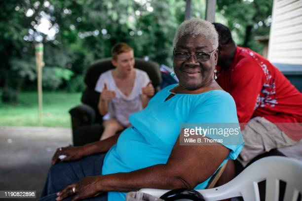 senior black woman at family cookout - african american ethnicity stock pictures, royalty-free photos & images
