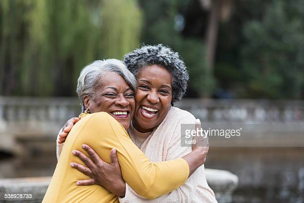 Senior black women embracing