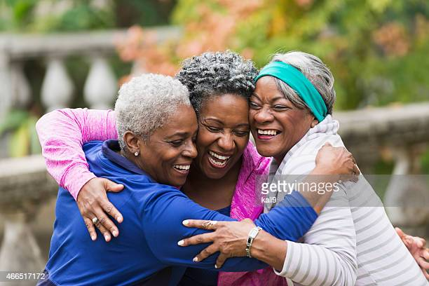 Senior black women hugging