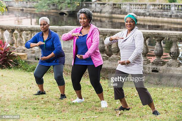 Senior black women practicing Tai Chi