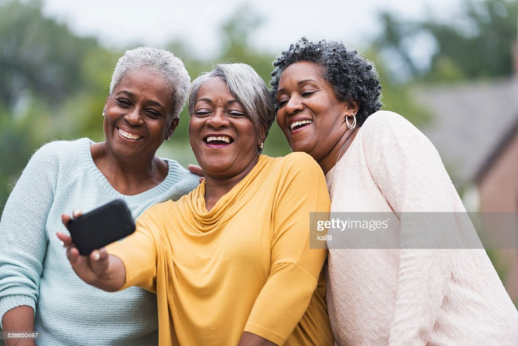 Senior black women taking a selfie : Stock Photo