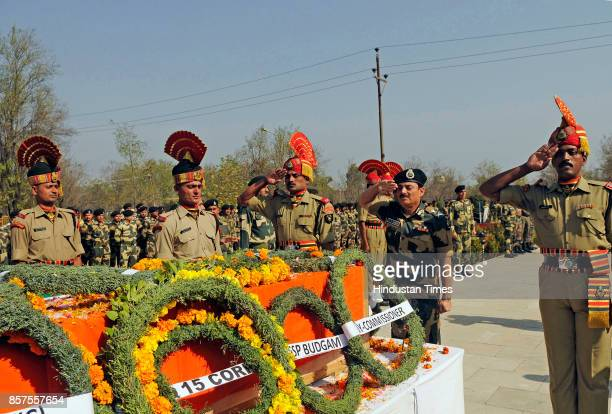 Senior Border Security Force officials salute as they pay their respects during a wreath laying ceremony of Brij Kishore Yadav a 50yearold assistant...