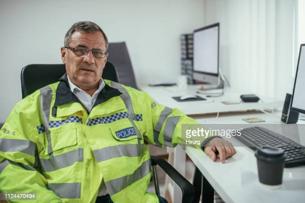 senior british police officer - officer stock pictures, royalty-free photos & images