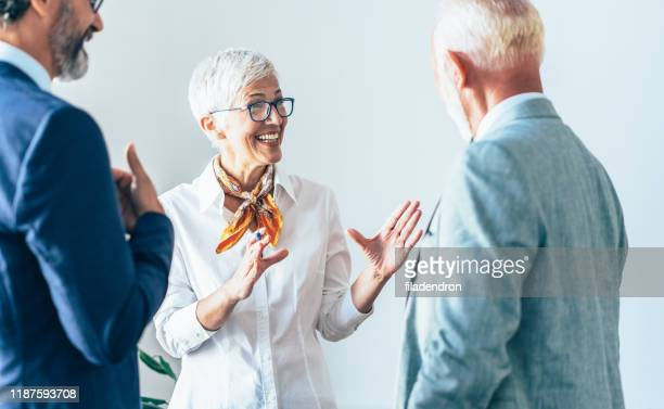 senior business conversation - business relationship stock pictures, royalty-free photos & images