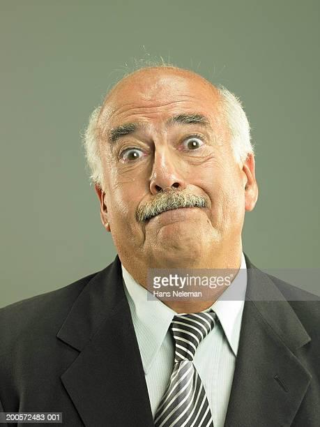 Senior business man expressing dismay, portrait