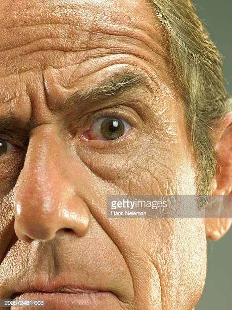 Senior business man frowning, close-up, portrait