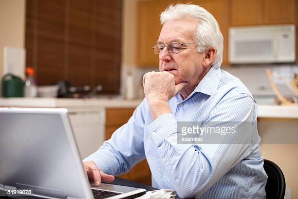 Senior Business Man Preparing Taxes