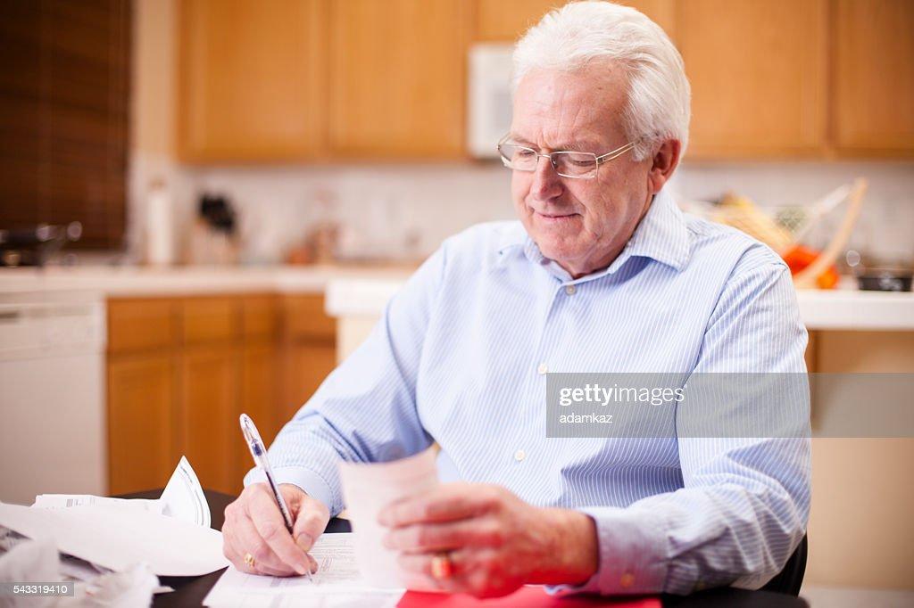 Senior Business Man Preparing Taxes : Stock Photo