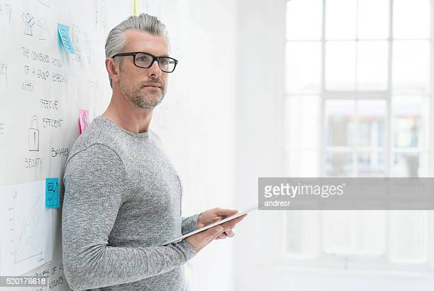 Senior business man using a tablet