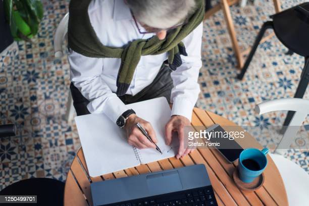 senior business man working in a coffee bar - one senior man only stock pictures, royalty-free photos & images