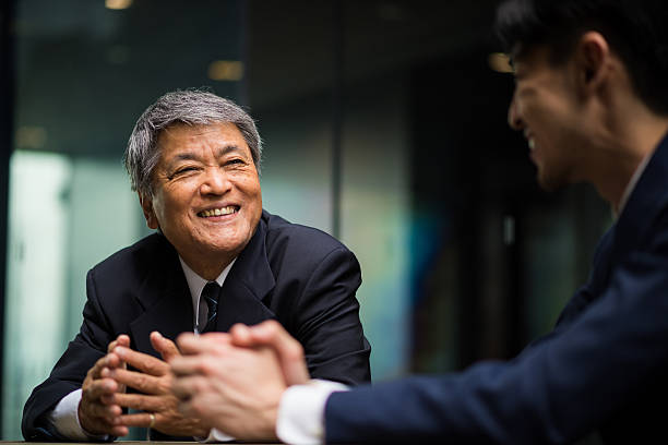 senior business mentor - asian man wearing suit stock pictures, royalty-free photos & images