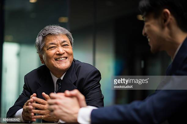 senior business mentor - japanese culture stock pictures, royalty-free photos & images